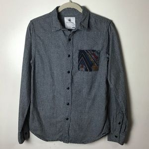 On the Byas gray button up shirt. Small